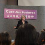 The speaker shares on the podium photo 1.