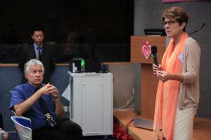 The speaker shares on the podium photo 9.