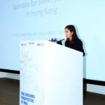 The speaker shares on the podium photo 5.