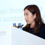 The speaker shares on the podium photo 4.
