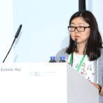 The speaker shares on the podium photo 13.